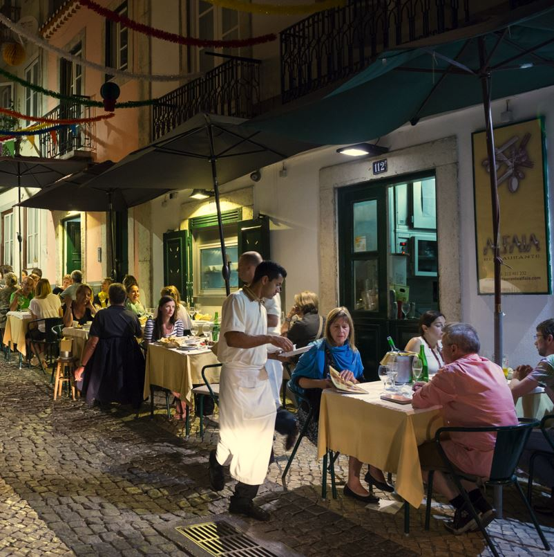 Bairro Alto Lisbon, tables outside restaurant and diners
