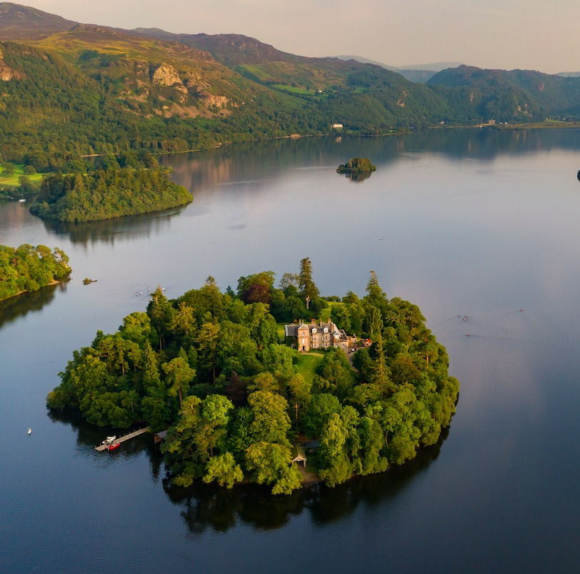 Aerial view of a large, beautiful lake with islands at sunset (Derwent Water, Lake District, England)