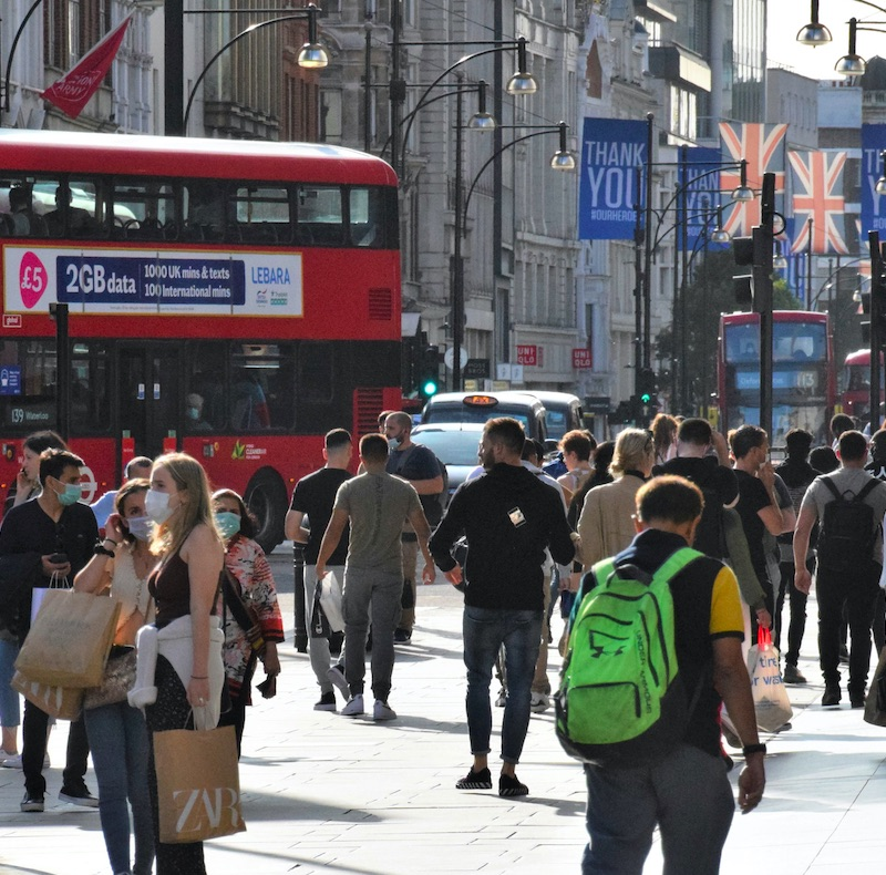 London, United Kingdom - September 17 2020: Crowd of people, some with protective face masks, on Oxford Street, daytime view