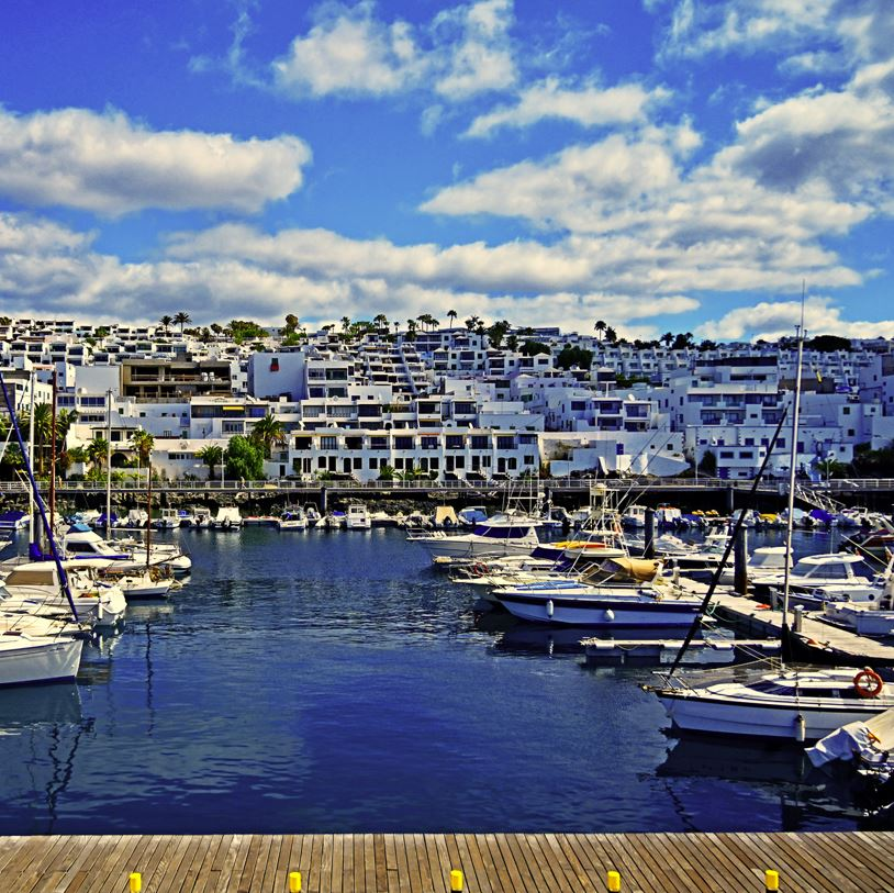 Puerto del Carmen marina and houses and boats