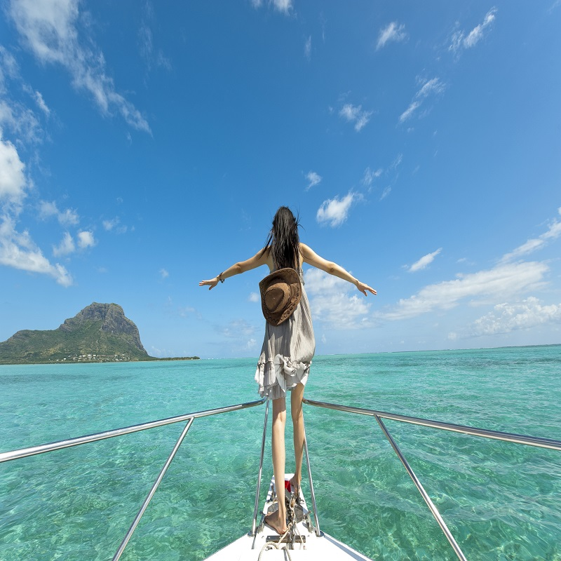 Women On A Boat In Mauritius
