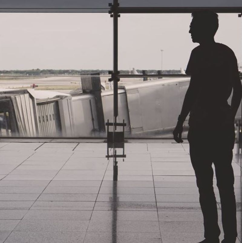 shadow of a man standing at Barcelona airport