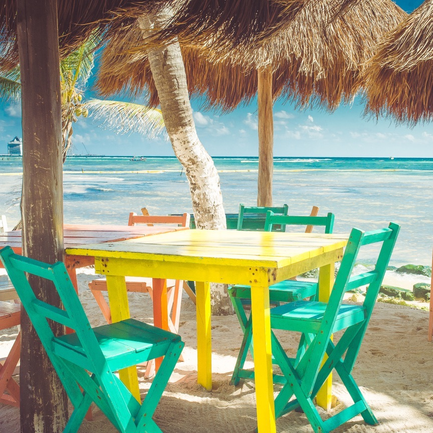 Colorful outdoor tables at the beach in Mexico