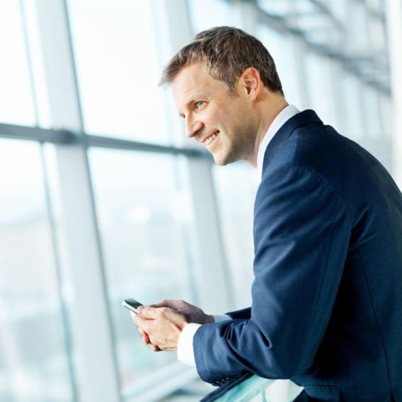businessman phone airport