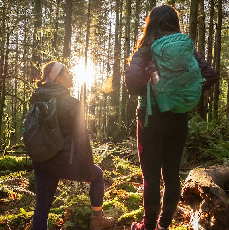Teen and young adult Eurasian sisters hiking in Mt. Seymour Provincial Park, North Vancouver, British Columbia, Canada
