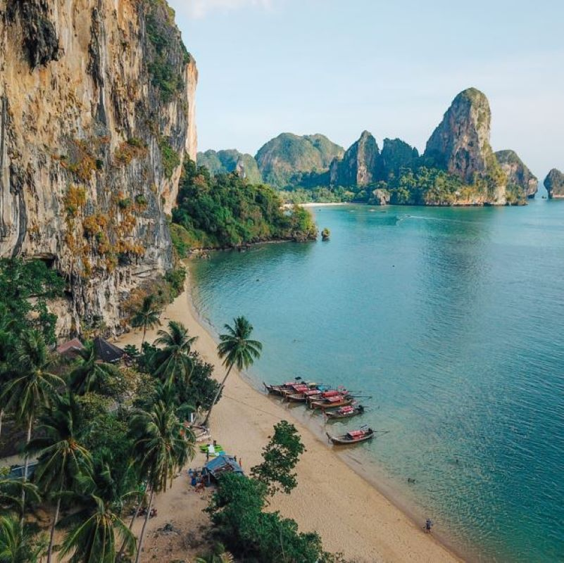 aerial photo of railey beach with karst peak mountains in Thailand