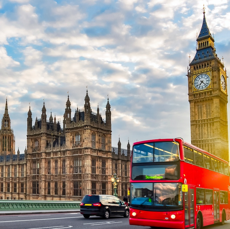 Big Ben and red double decker bus in London, England