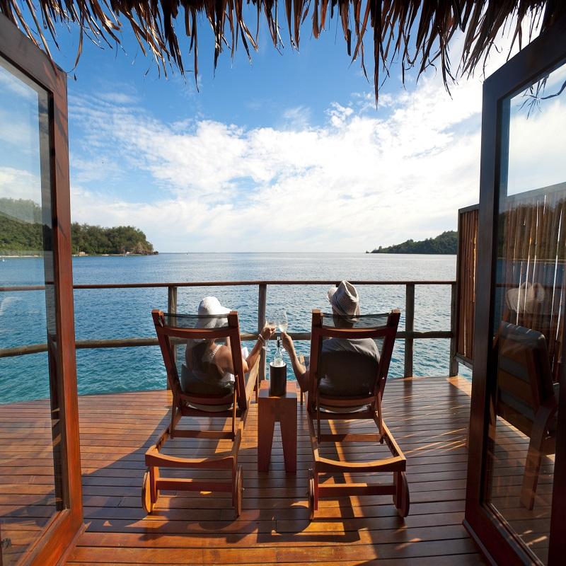 Couple Enjoy The Sunset In Fiji
