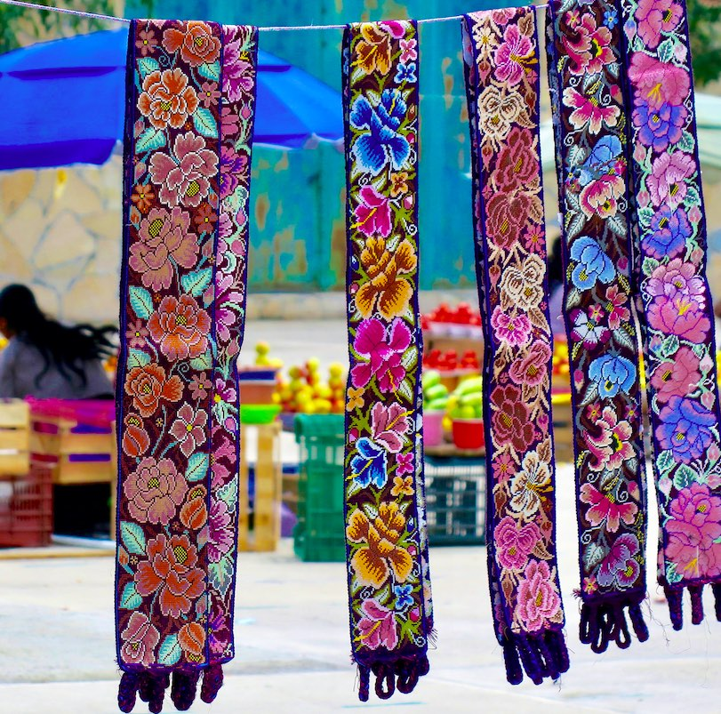 Zinacantán is a quint highland Tzotzil village in Mexico, known for its indigenous handwoven shawls and huipils with vibrant, colorful floral patterns.