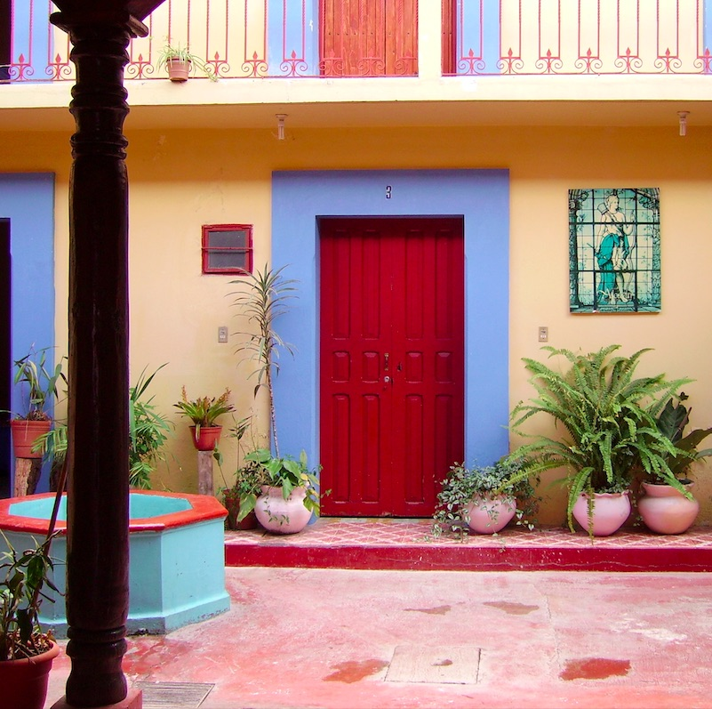 interior of a colonial house with yellow walls in San Cristobal, Mexico