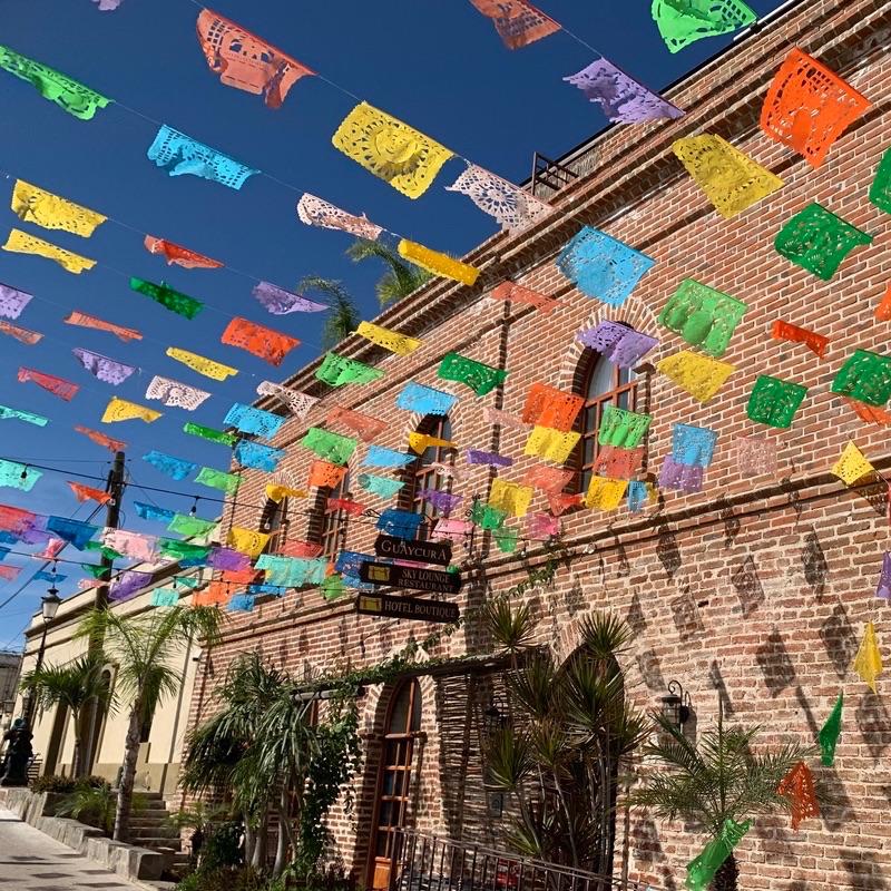 papel picado hanging next to a building in Baja California, Mexico
