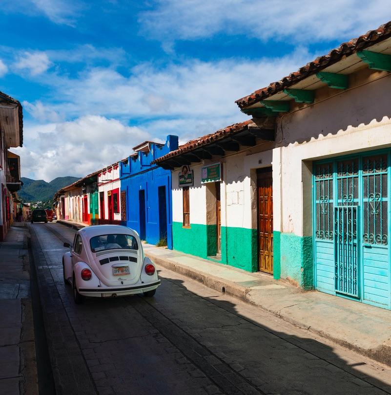 View of a street with colorful buildings in the town of San Cristobal de Las Casas, in Chiapas, Mexico.