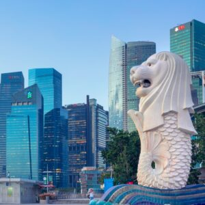 View of the merlion statue of Merlion Park, and the financial district in downtown Singapore. The merlion is a symbol and mascot of Singapore.