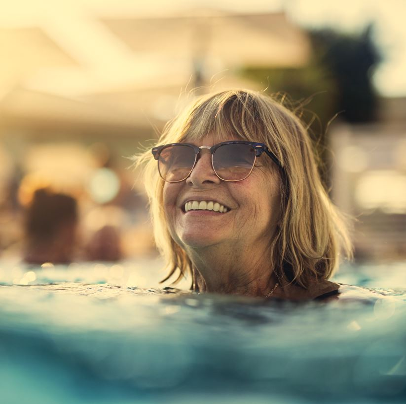 Woman swimming in outdoor pool