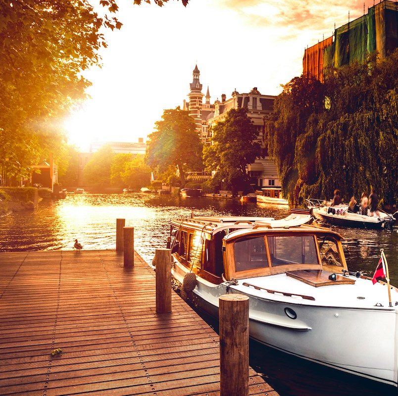 boat by the canal in amsterdam