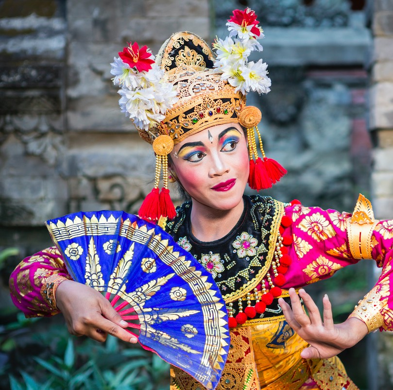 A young Bali female dancer is performing the Ramayana dance in a temple of Bali, in Indonesia. The Hindu culture in Bali is still preserved today and attracts millions of visitors in the Island of Gods for its the culture and natural beauty