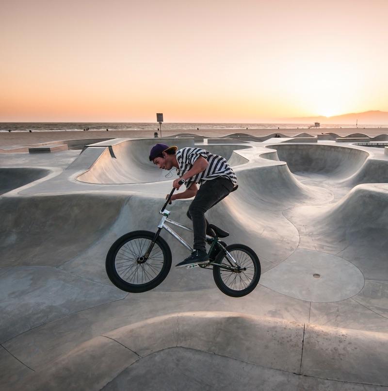 biker on the skateboard platform in Venice Beach, Los Angeles California