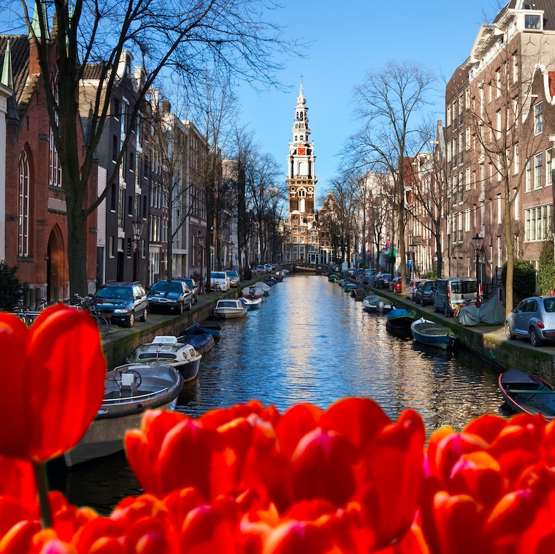 canal in amsterdam during the day