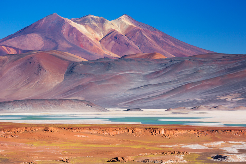 The salt lake Salar de Talar with surrounding volcanoes in the Atacama Desert, Chile.