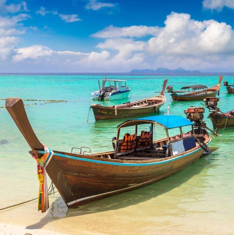 longtail boats thailand beach