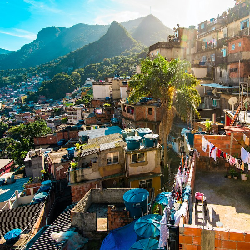 View of Rocinha slum, one of the biggest in Brazil, with big mountains at the horizon, in Rio de Janeiro.