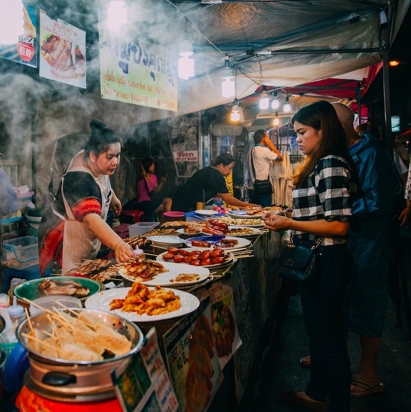 Thai woman sales at the Saturday Night Market on August 27, 2016 in Chiang Mai, Thailand.