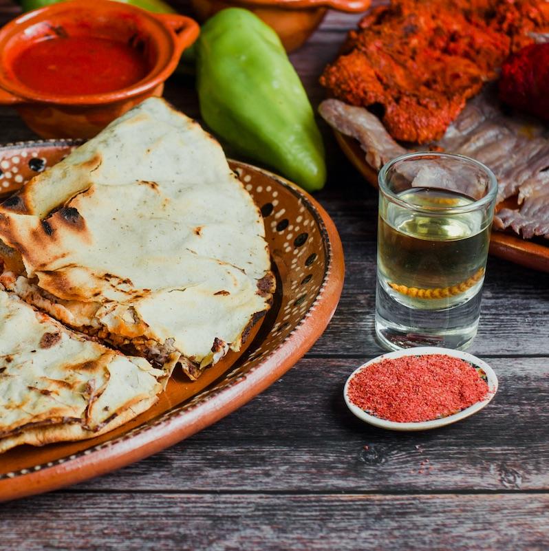 tlayuda plate with a shot of mezcal