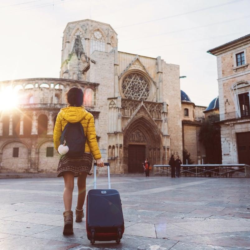 ourist woman visiting Valencia, Plaza de la Virgen