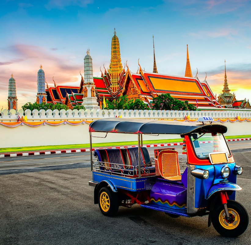 tuk tuk parked in front of the Grand Palace in Bangkok, Thailand