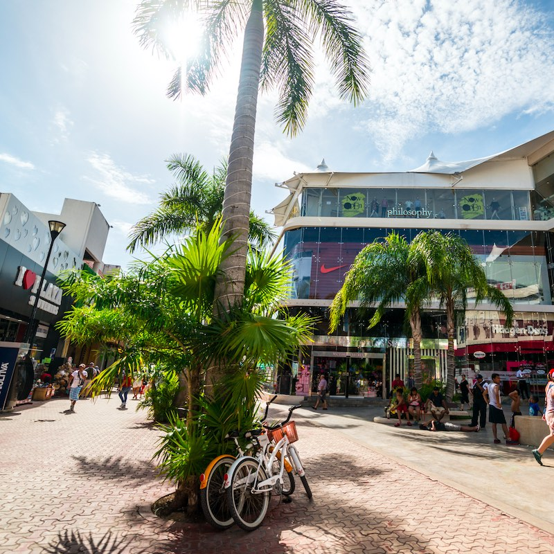 Playa Del Carmen, Mexico - December 27, 2016: People shopping and resting at shopping mall on famous 5th Avenue, shopping street on Playa del Carmen