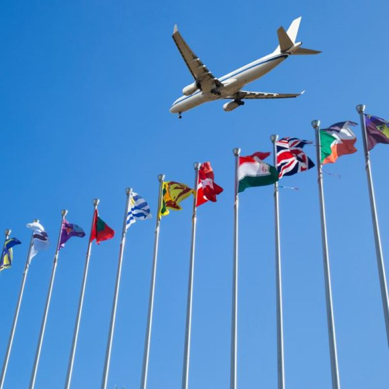 airplane over flags