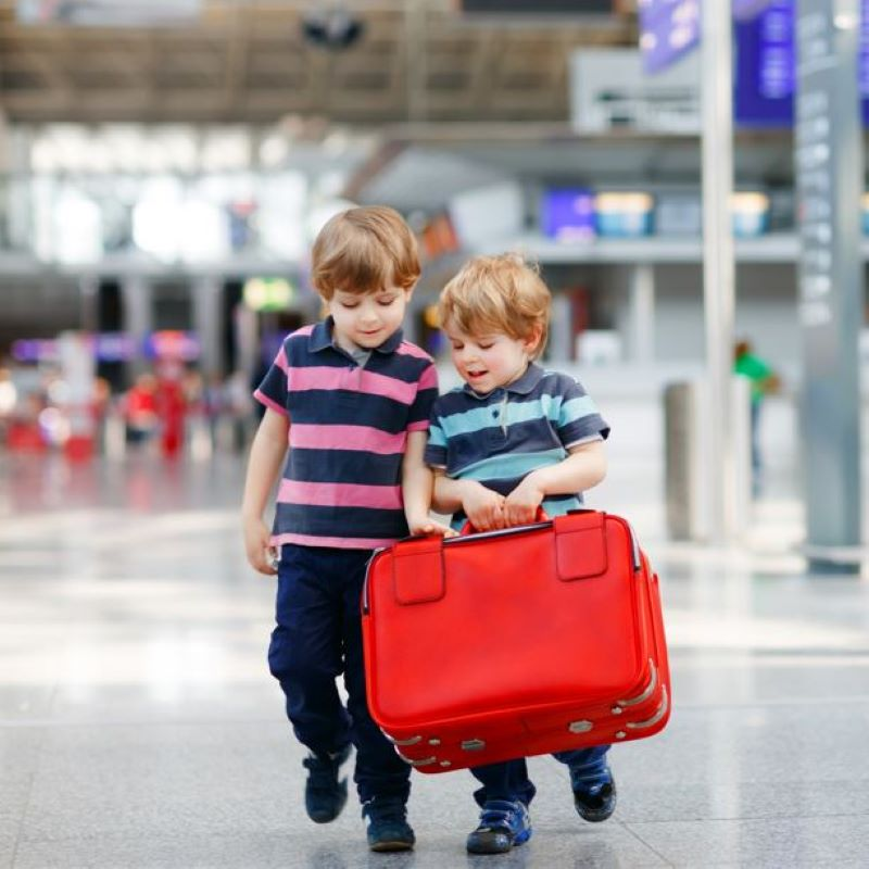 children airport check in suitcase luggage