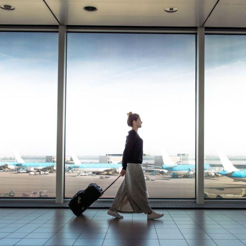 female travelers suitcase