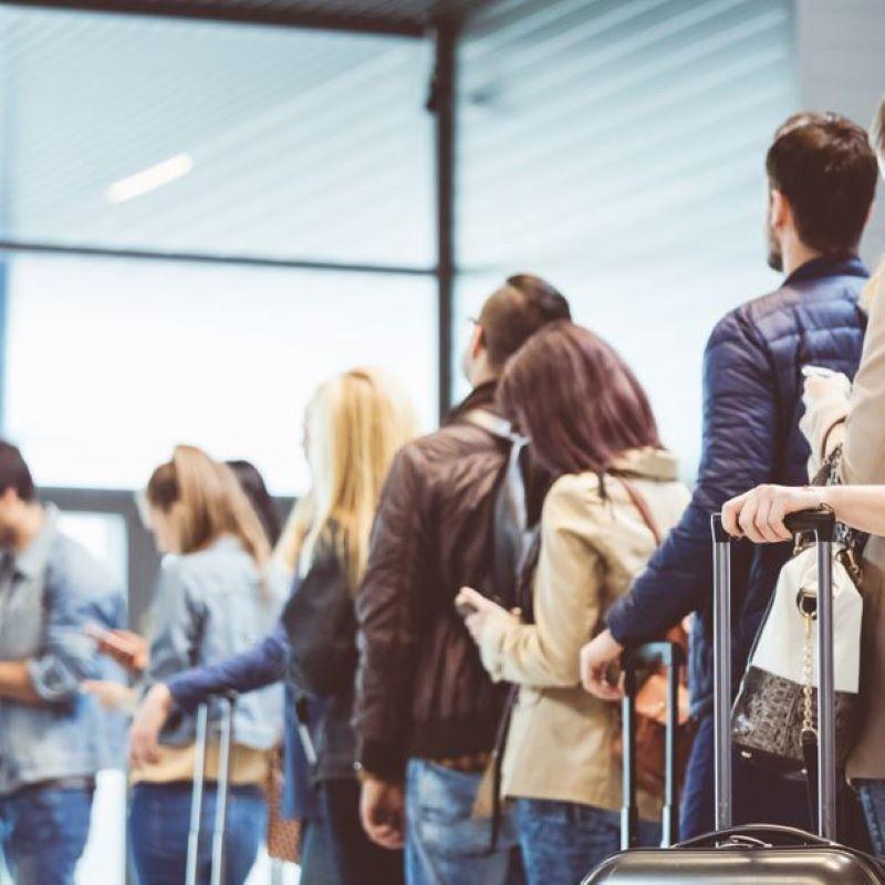 travelers queue check in